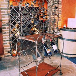 A wrought iron grilles and accessories for a wine cellar