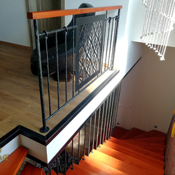 Interior staircase railing in industrial style in a family house