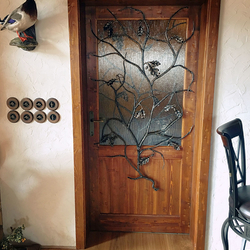 Artistic wrought iron grille in the shape of oak branch