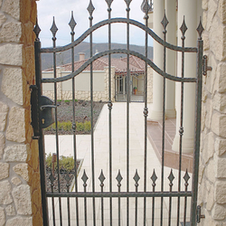 A forged gate as a part of family villa fence
