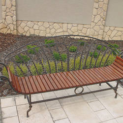 A wrought-iron garden bench in a combination with wood for your comfort
