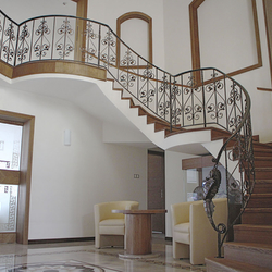 A curved wrought iron railing