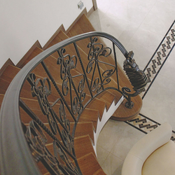 An exclusive curved railing in a family villa interior – forged railing