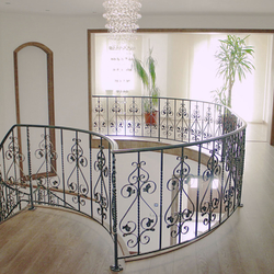 A curved wrought iron railing - interior railing