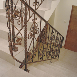 A forged indoor staircase railing into the cellar