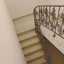A wrought-iron staircase railing into the cellar – interior railing