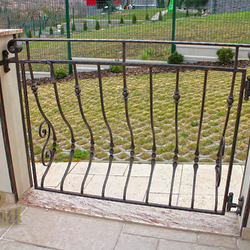 A wrought iron terrace gate