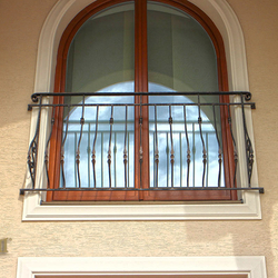 A wrought iron railing - a French window