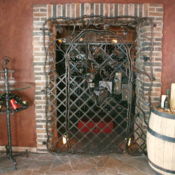 A wrought iron grille and accessorier for a wine cellar