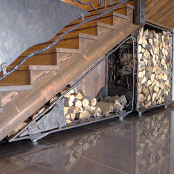 A special hand wrought iron firewood rack in a luxurious cottage