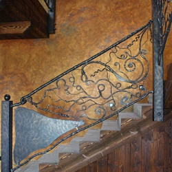 Hand wrought iron interior staircase railing - Roots